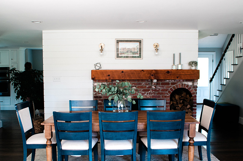 Remodeled dining area with fireplace and table.